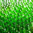 Bunch of green glass bottles. Soft focus. — Foto Stock #4565502