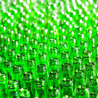 Bunch of green glass bottles. Soft focus. — Stock Photo #4565540