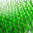 Bunch of green glass bottles. Soft focus. — Stock Photo #4565570