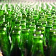 Stock Photo: Bunch of green glass bottles. Soft focus.
