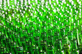 Bunch of green glass bottles. Soft focus. — Photo