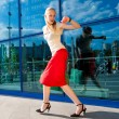 Young woman, blond, runs against the backdrop of the station. In — Stock Photo