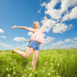 Pretty girl having fun flying in blue sky - ストック写真