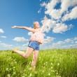 Pretty girl having fun flying in blue sky — Stock Photo #4708024