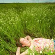 Pretty girl having fun in the field - ストック写真