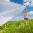 Pretty girl having fun flying in blue sky — Stock Photo #4708052