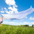 Pretty girl having fun flying in blue sky — Stock Photo