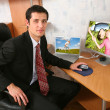 Stock Photo: Businessman with laptop