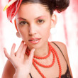 Trend model with a red flower on the head. Ideal skin. With a br — Stock Photo