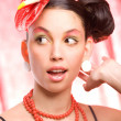 Trend model with a red flower on the head. Ideal skin. With a br — Stock Photo #4708225