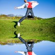 Happy young man - jumping end flies in blue sky — Stock Photo #4708231