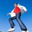 Happy young man - jumping end flies in blue sky — Stock Photo #4708238