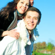 Royalty-Free Stock Photo: Young love Couple smiling under blue sky