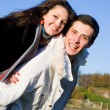 Young love couple smiling under blue sky — Stock Photo #4708245