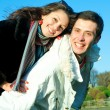 Young love Couple smiling under blue sky — Stock Photo #4708247
