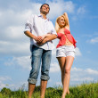 Young couple standing on summer meadow — Stock Photo #4708413