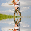 Happy Young love Couple - jumping under blue sky — Stock Photo #4708421