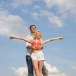 Young couple under cloudy sky — Stock Photo #4708446