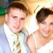 Portrait smiling groom and bride in wedding car — Stok fotoğraf
