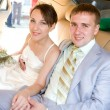 Stock Photo: Portrait smiling groom and bride in wedding car