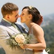 Bride and groom kissing — Stock Photo #4708575