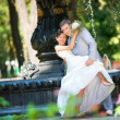 Groom and the bride joy against backdrop fountain. In all growth — Stock Photo #4708594