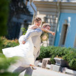 Groom and bride jumping — Stock Photo