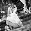 Groom and the bride joy against backdrop fountain. In all growth — Stock Photo
