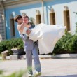 Groom and bride runinng — Stock Photo
