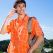 Young man from the phone calls. It was on Mount. Against a blue — Stock Photo #4708622