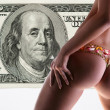 Stock Photo: Girl with a flower underwear backdrop of money, 100 american dol