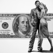 Young beautiful couple under money — Stock Photo