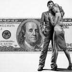Young beautiful couple under money — Stock Photo #4708647
