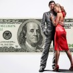 Young beautiful couple under money — Stock Photo #4708648