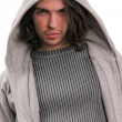 Portrait of young man dressed in modern clothes with a hood — Stock Photo #4708649