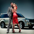 Young beautiful couple backdrop car - Stock Photo
