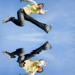 Happy young man - jumping end flies in blue sky. — Stock Photo