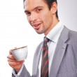 Businessman drinking coffee with a cup — Stock Photo