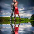Young couple with storm cloudy sky — Stock Photo #4708730