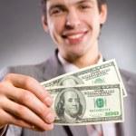 Бизнесмен с деньгами — Стоковое фото