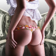 Stock Photo: Buttocks decorated with flowers under money, 100 american dollar