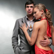 Man and woman. Young woman embraces man. Woman in a red dress. Woman looks at the man — Stock Photo