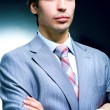 Portrait of the businessman in suit - Stock Photo
