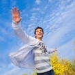 Happy young man jumping against background of sky and trees — Stock Photo #4708840