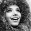 Portrait of the beautiful, smiling young woman with a fur hood. — Stock Photo #4708941