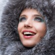 Portrait of the beautiful, smiling young woman with a fur hood. — Stock Photo #4708942