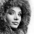 Portrait of the beautiful young woman with a fur hood — Stock Photo