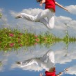 Happy young woman jumping — Stock Photo