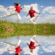 Happy Young love Couple - jumping under blue sky — Stock Photo