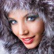 Smiling young woman with a fur hood — Stock Photo #4709169